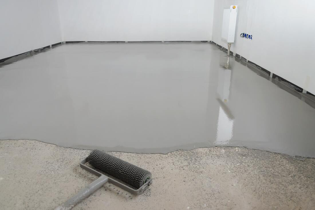 This picture shows concrete floor leveling work being done for a client in Coquitlam.