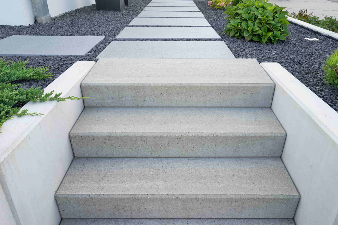Modern concrete steps installed in a luxury homes backyard.