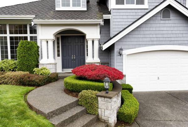 Exposed aggregate concrete was used for the driveway and stairs for this Coquitlam home.